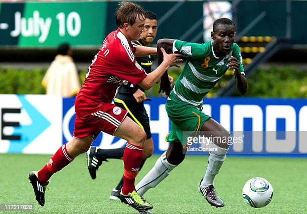 Victorien Angban of Ivory Coast struggles for the ball with Lasse Christensen of Denmark during a FIFA U17 World Cup Mexico 2011 Group F match at the...