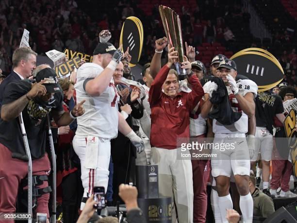 A victorious Alabama Crimson Tide Head Coach Nick Saban hoists the College Football National Championship Trophy after the College Football Playoff...
