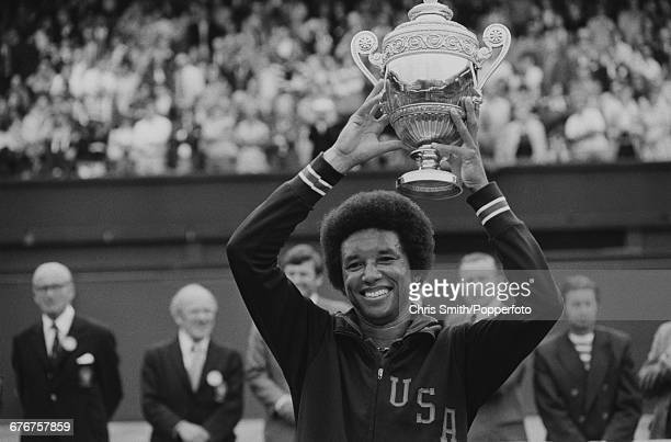 Victorious American tennis player Arthur Ashe holds up the Gentlemen's Singles Trophy after winning the final of the Men's Singles tournament against...