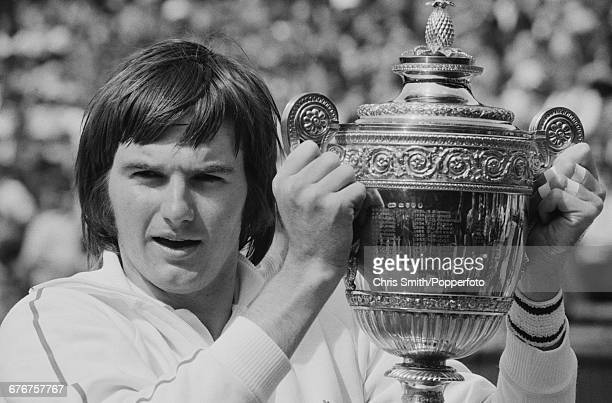 Victorious American tennis player Jimmy Connors holds up the Gentlemen's Singles Trophy after winning the final of the Men's Singles tournament...