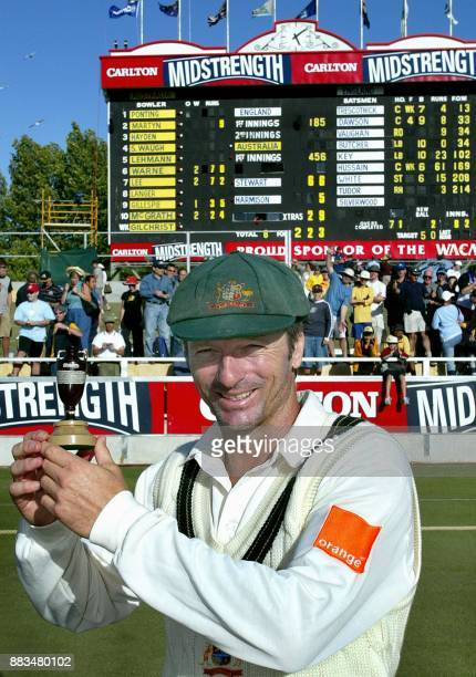 Victorious Australian captain Steve Waugh holds a replica of the Ashes urn in front of the scoreboard, after his sides win on day three of the third...