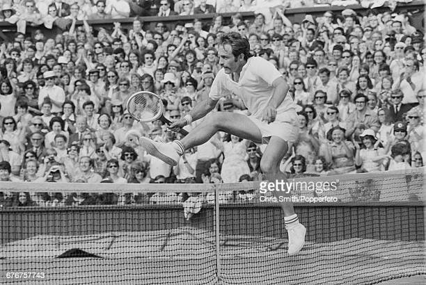 Victorious Australian tennis player John Newcombe jumps over the Centre Court net after winning the final of the Men's Singles tournament against...