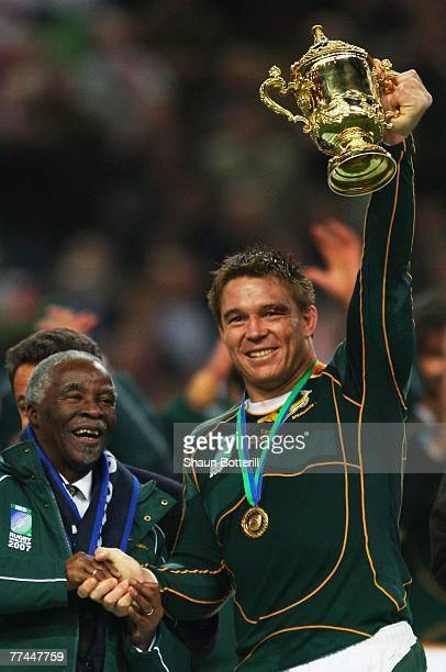 20 Victorious captain John Smit of South Africa lifts the trophy with South Africa President Thabo Mbeki at his side during the 2007 Rugby World Cup...