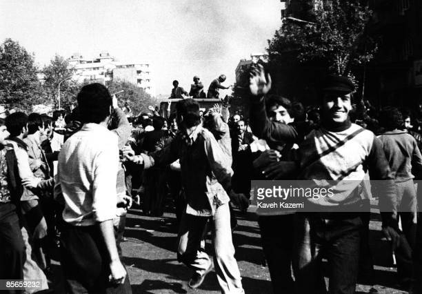 A victorious crowd with the conceding army following them in vehicles in Tehran in the late afternoon of the day the victory of the Iranian...