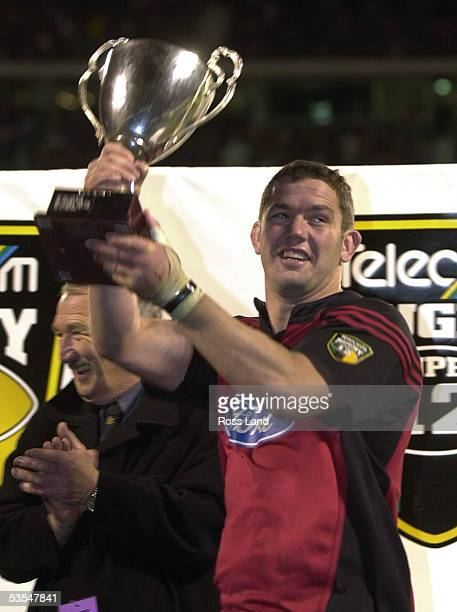Victorious Crusaders captain Reuben Thorne holds the Super12 rugby trophy aloft after his team beat the Brumbies 3113 in the final at Jade Stadium,...