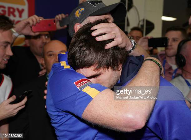 A victorious Eagles head coach Adam Simpson consoles the suspended Andrew Gaff of the Eagles who didnt play after their win during the 2018 AFL Grand...