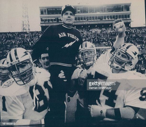 DEC 31 1982 JAN 1 1983 Victorious FalconsAir Force Academy Head Coach Ken Hatfield is hoisted on top of the shoulders of players Dave Timm and Hugi...