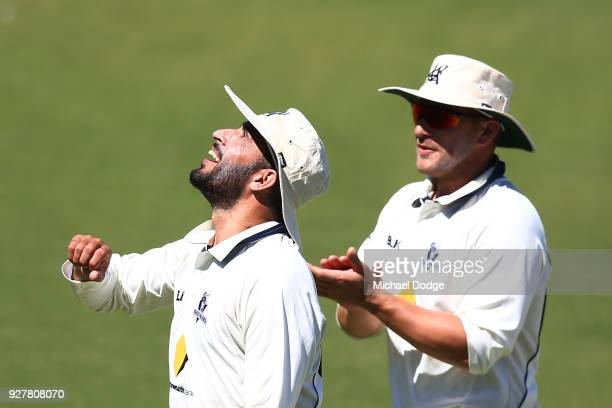 A victorious Fawad Ahmed of Victoria celebrates with Aaron Finch after taking a five wicket haul during day five of the Sheffield Shield match...