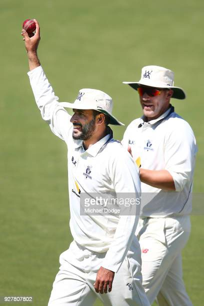 A victorious Fawad Ahmed of Victoria holds up the ball after taking a five wicket haul during day five of the Sheffield Shield match between Victoria...