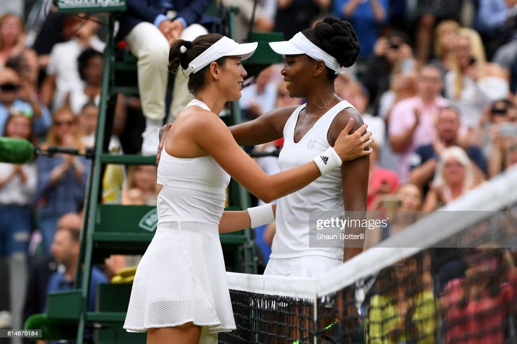 A victorious Garbine Muguruza of Spain is embraced by Venus Williams of The United States after the Ladies Singles final on day twelve of the Wimbledon Lawn Tennis Championships at the All England Lawn Tennis and Croquet Club at Wimbledon on July 15, 2017 in London, England.