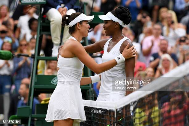 A victorious Garbine Muguruza of Spain is embraced by Venus Williams of The United States after the Ladies Singles final on day twelve of the...