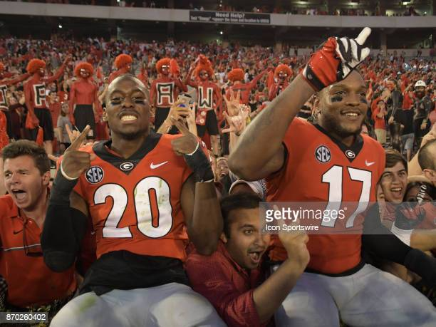 A victorious Georgia Bulldogs defensive back JR Reed and Georgia Bulldogs linebacker Davin Bellamy celebrate after the game between the South...