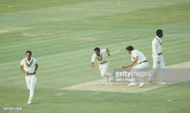 Victorious India players Yaspal Sharma and Roger Binny grab souvinir stumps as Mohinder Amarnath runs off the field as West Indies batsman Michael...