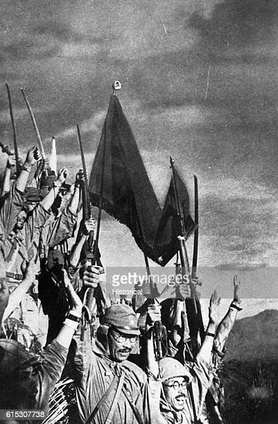 Victorious Japanese troops celebrate after taking Bataan in the Philippines in April 1942.