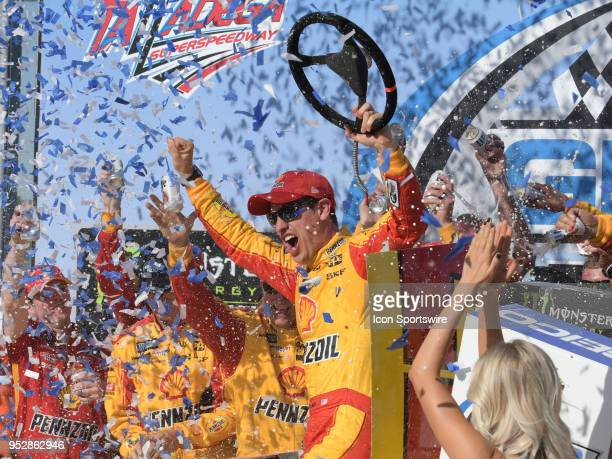 A victorious Joey Logano Team Penske Ford Fusion Shell Pennzoil in Victory Lane after winning the Monster Energy Cup Series 49th Annual Geico 500 on...