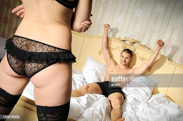 victorious man lying and woman's back - women dressed undressed stock pictures, royalty-free photos & images