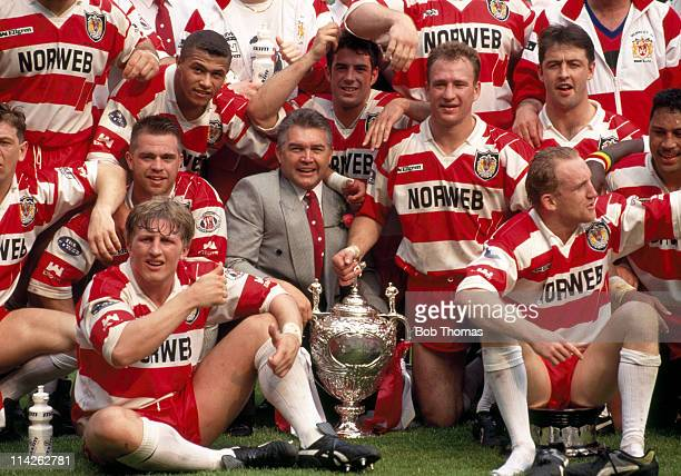 Victorious members of the Wigan rugby league team with their coach John Monie and the trophy after their victory over Widnes in the Silk Cut...