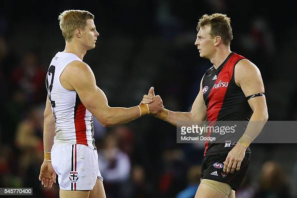 A victorious Nick Riewoldt of the Saints and Brendon Goddard of the Bombers shake hands during the round 16 AFL match between the Essendon Bombers...