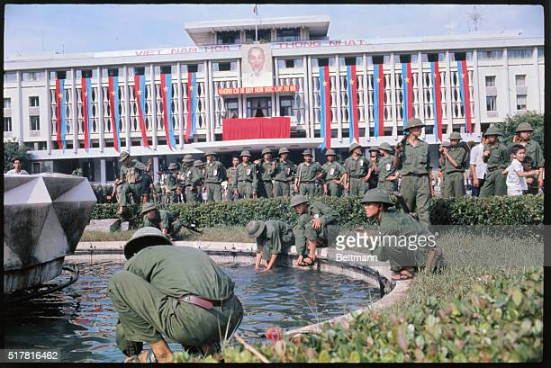 Victorious North Vietnamese troops wash in the fountain of Saigon's Presidential Palace
