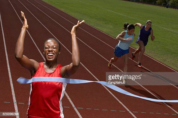 victorious runner - forward athlete stock pictures, royalty-free photos & images