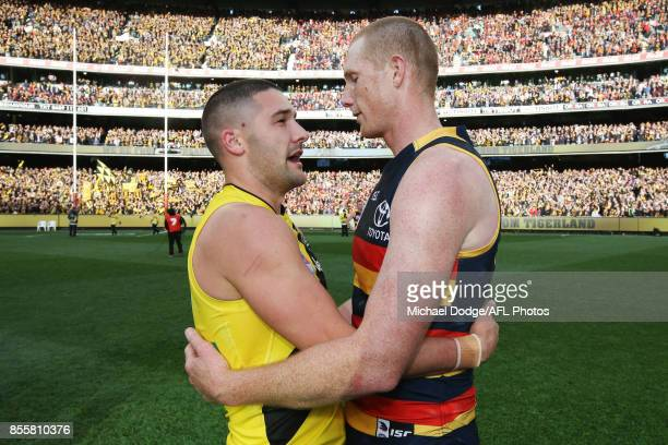 A victorious Shaun Grigg of the Tigers consoles Sam Jacobs of the Crows during the 2017 AFL Grand Final match between the Adelaide Crows and the...