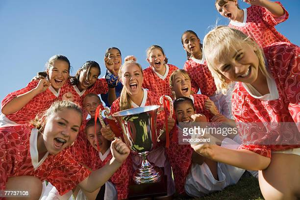 victorious soccer team with trophy - teen awards foto e immagini stock