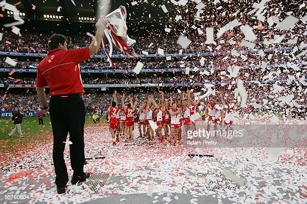 Victorious Swans Coach Paul Roos hold the trophy aloft after the 2005 AFL Grand Final between the Sydney Swans and the West Coast Eagles at the...