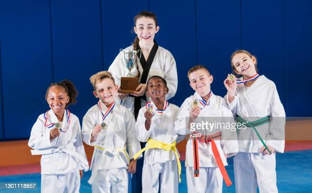 victorious taekwondo team - martial arts stock pictures, royalty-free photos & images