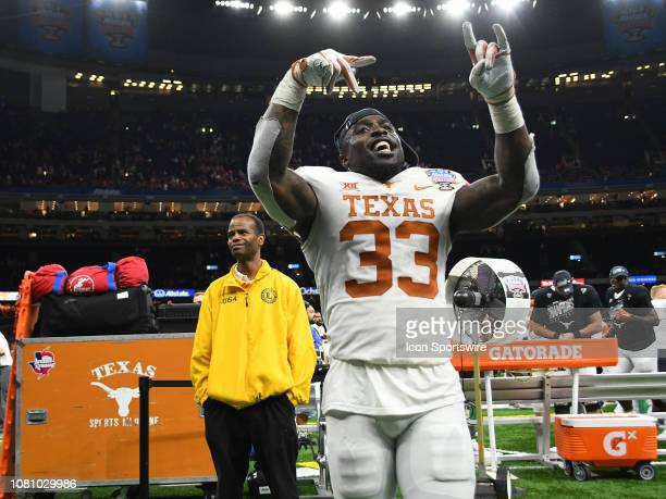 A victorious Texas Longhorns Linebacker Gary Johnson celebrates after the Allstate Sugar Bowl between the Texas Longhorns and the Georgia Bulldogs on...