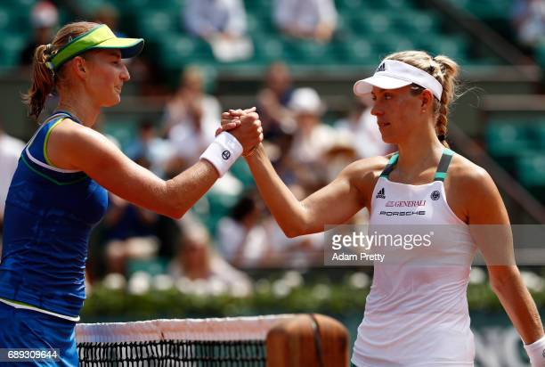 Victorius Ekaterina Makarova of Russia shakes hands with Angelique Kerber of Germany after the ladies singles first round match on day one of the...