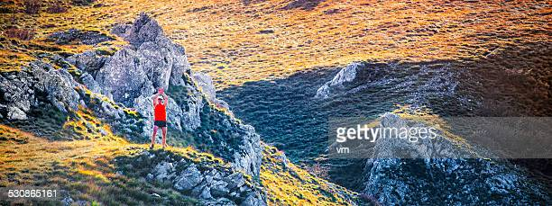 victorius trail runner on a rocky grass road s - human limb stock pictures, royalty-free photos & images