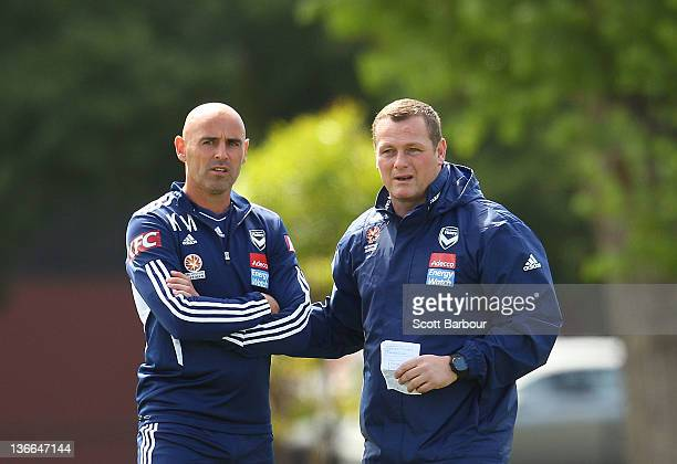 Victory assistant coach Kevin Muscat and head coach Jim Magilton look on during a Melbourne Victory A-League training session at Gosch's Paddock on...