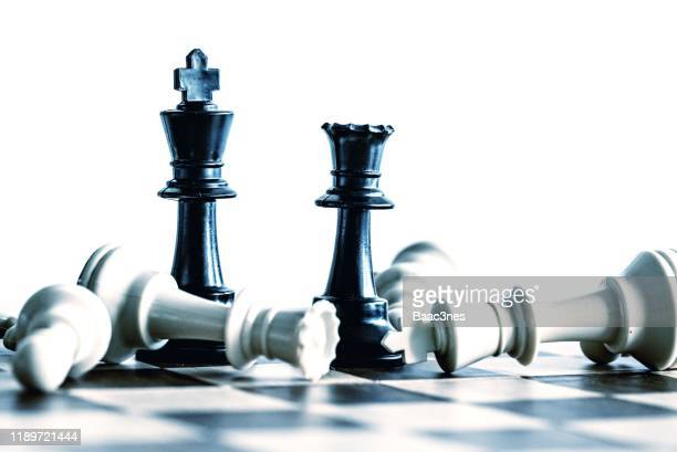 victory - black beats white - chess piece stock pictures, royalty-free photos & images