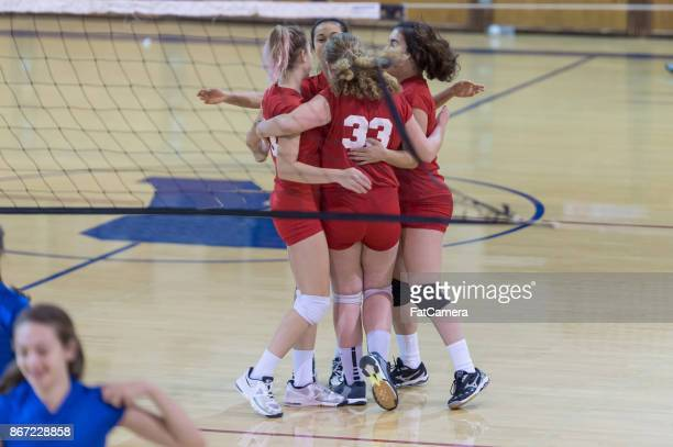 victory celebration! - high school volleyball stock photos and pictures