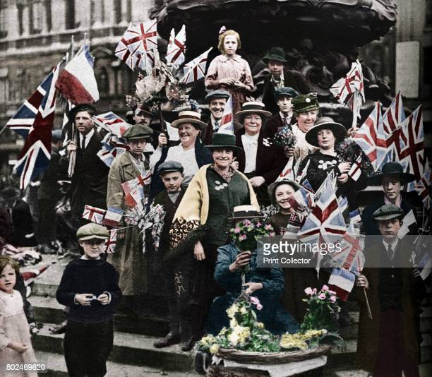 Victory celebrations underneath Eros Piccadilly London The First World War victory parade Sunday 19th July 1919 From These Tremendous Years 19191938...