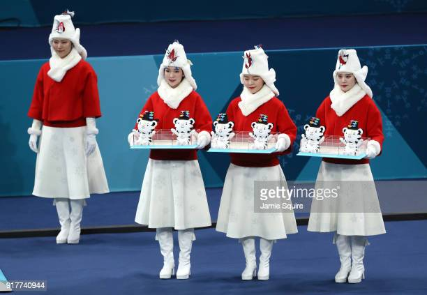 Victory ceremony presenters look on during the Curling Mixed Doubles Gold Medal Game between Canada and Switzerland on day four of the PyeongChang...