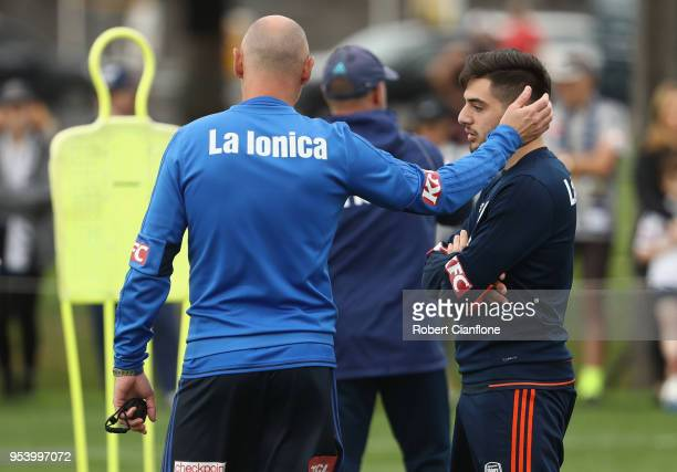Victory coach Kevin Muscat speaks to Christian Theoharous of the Victory during a Melbourne Victory ALeague training session at Gosch's Paddock on...