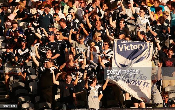 Victory fans celebrate a goal during the round 18 A-League match between the Central Coast Mariners and the Melbourne Victory at Bluetongue Stadium...
