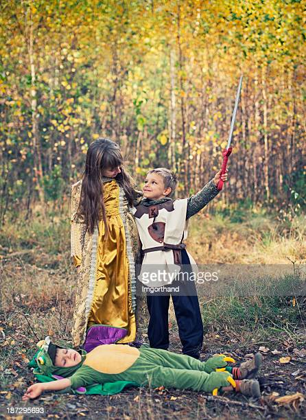 victory for the little knight! - monster fictional character stock pictures, royalty-free photos & images