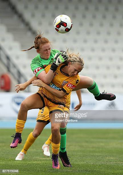 Victory goalkeeper Bethany MasonJones is challenged by Alyssa Mautz of the Glory during the round five WLeague match between Melbourne Victory and...