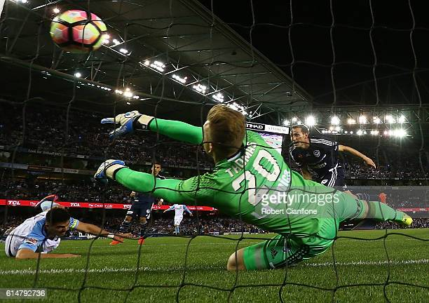 Victory goalkeeper Lawrence Thomas is beaten by a shot from Bruno Fornaroli of Melbourne City during the round two ALeague match between Melbourne...