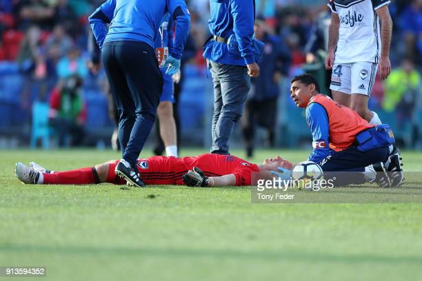 Victory goalkeeper Lawrence Thomas is injured during the round 19 ALeague match between the Newcastle Jets and the Melbourne Victory at McDonald...