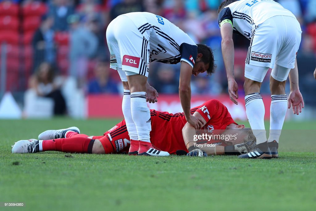 Victory goalkeeper Lawrence Thomas is injured during the round 19 A-League match between the Newcastle Jets and the Melbourne Victory at McDonald Jones Stadium on February 3, 2018 in Newcastle, Australia.