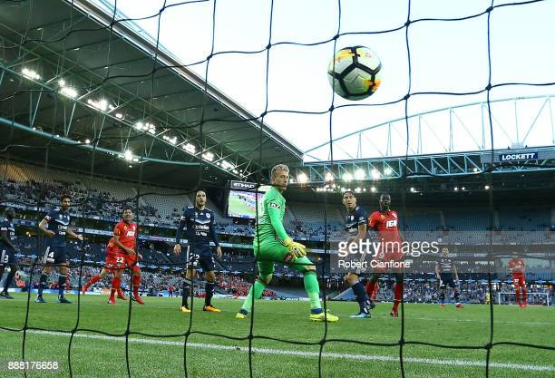Victory goalkeeper Lawrence Thomas looks on as he is beaten by a header from Paba Babacar Diawara of Adelaide United during the round 10 ALeague...