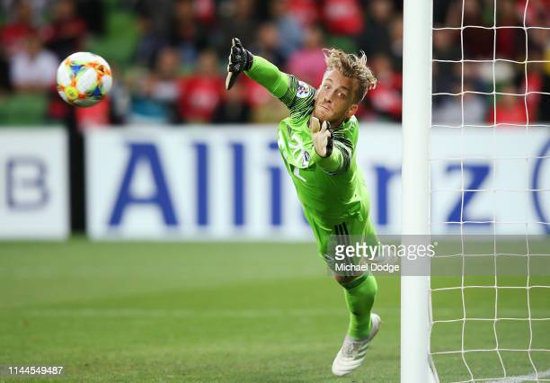 Victory goalkeeper Lawrence Thomas makes a save during the round 1 AFC Champions League Group F match between Melbourne Victory and Guangzhou...