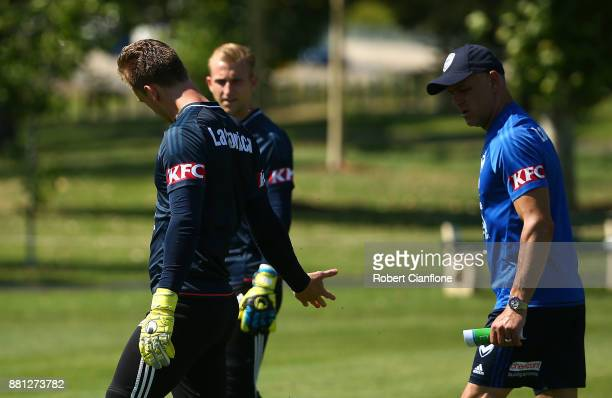 Victory goalkeeper Lawrence Thomas shows his hand to goalkeeping coach Dean Anastasiadis during a Melbourne Victory ALeague training session at...