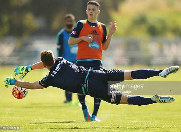 Victory goalkeeper Lawrence Thomas stops an attack by George Howard during a Melbourne Victory ALeague training session at AAMI Park on October 8...