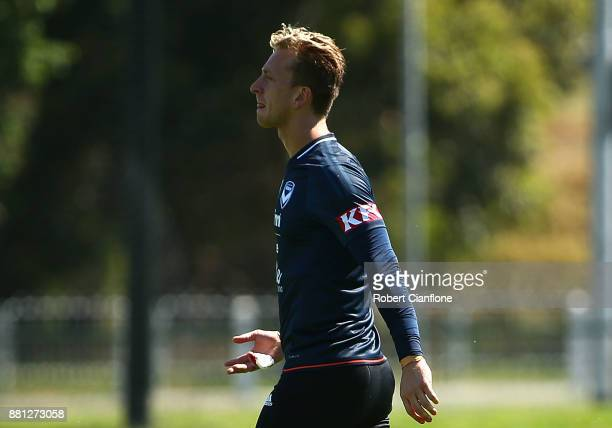 Victory goalkeeper Lawrence Thomas walks off the training pitch after sustaining an injury to his right hand during a Melbourne Victory ALeague...