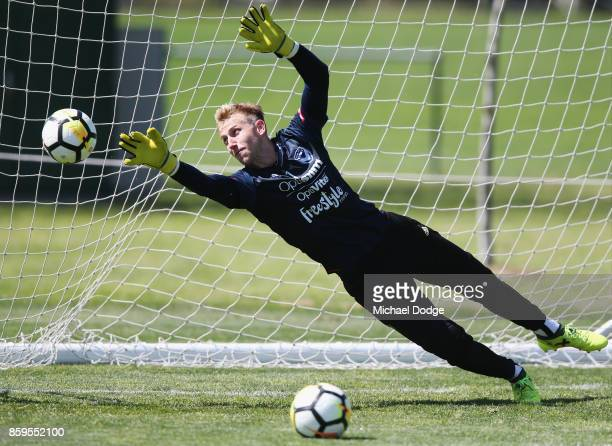 Victory goalkeeper Matt Acton dives for the ball during a Melbourne Victory ALeague training session at Gosch's Paddock on October 10 2017 in...