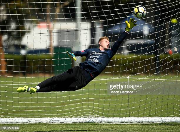 Victory goalkeeper Matt Acton dives for the ball during a Melbourne Victory ALeague training session at Gosch's Paddock on November 29 2017 in...